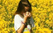 girl with hayfever in field of flowers